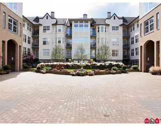 """Photo 1: 118 20200 56TH Avenue in Langley: Langley City Condo for sale in """"The Bentley"""" : MLS®# F2808875"""