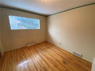 Photo 13: 96 HOLLYBURN Road SW in Calgary: Haysboro Detached for sale : MLS®# C4295874