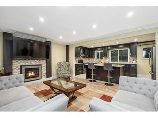 Photo 1: 3228 CEDAR Drive in Port Coquitlam: Lincoln Park PQ House for sale : MLS®# R2526313