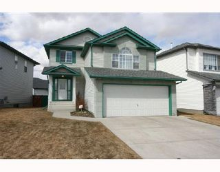 Photo 1: 78 ARBOUR BUTTE Road NW in CALGARY: Arbour Lake Residential Detached Single Family for sale (Calgary)  : MLS®# C3320004