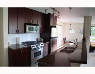 "Photo 3: 310 6888 SOUTHPOINT Drive in Burnaby: South Slope Condo for sale in ""CORTINA"" (Burnaby South)  : MLS®# V714781"