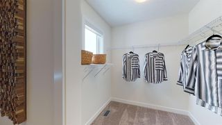 Photo 10: 192 Crestridge Common SW in Calgary: Crestmont Row/Townhouse for sale : MLS®# A1038362