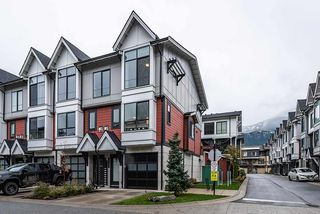 "Photo 1: 38344 SUMMITS VIEW Drive in Squamish: Downtown SQ Townhouse for sale in ""EAGLEWIND"" : MLS®# R2517770"