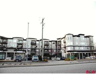 "Main Photo: 5765 GLOVER Road in Langley: Langley City Condo for sale in ""College Court"" : MLS®# F2706318"