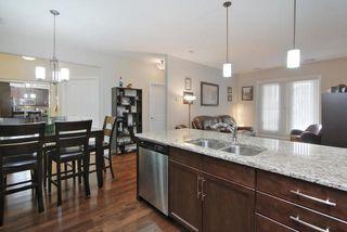 Photo 6: #104 6083 MAYNARD WY NW in Edmonton: Zone 14 Condo for sale : MLS®# E4165066
