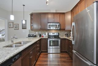 Photo 5: #104 6083 MAYNARD WY NW in Edmonton: Zone 14 Condo for sale : MLS®# E4165066