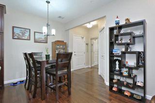 Photo 3: #104 6083 MAYNARD WY NW in Edmonton: Zone 14 Condo for sale : MLS®# E4165066