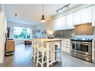"Photo 3: 101 9168 SLOPES Mews in Burnaby: Simon Fraser Univer. Condo for sale in ""VERITAS BY POLYGON"" (Burnaby North)  : MLS®# R2443492"