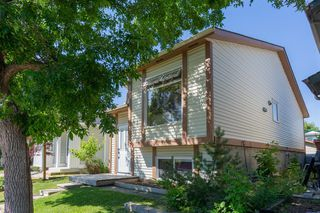 Photo 2: 52 RIVERBIRCH Road SE in Calgary: Riverbend Detached for sale : MLS®# A1017203