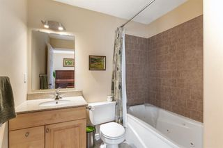 Photo 16: 52 RIVERBIRCH Road SE in Calgary: Riverbend Detached for sale : MLS®# A1017203