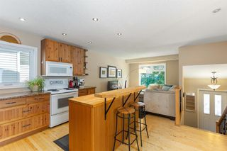Photo 8: 52 RIVERBIRCH Road SE in Calgary: Riverbend Detached for sale : MLS®# A1017203