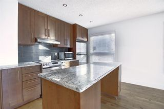 Photo 8: 100 Chaparral Ridge Circle SE in Calgary: Chaparral Semi Detached for sale : MLS®# A1044875