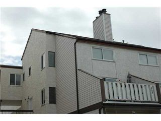 Photo 1: 165 LANCASTER TC in EDMONTON: Zone 27 Carriage for sale (Edmonton)  : MLS®# E3228462