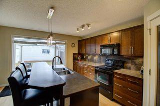 Photo 7: 232 Silverado Range Close SW in Calgary: Silverado Detached for sale : MLS®# A1047985