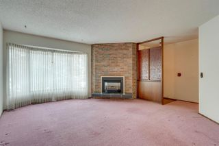 Photo 9: 7719 67 Avenue NW in Calgary: Silver Springs Detached for sale : MLS®# A1013847