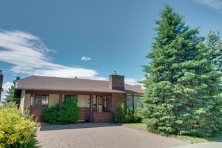 Photo 1: 7719 67 Avenue NW in Calgary: Silver Springs Detached for sale : MLS®# A1013847