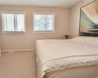 Photo 11: 816 MADEIRA Drive NE in Calgary: Marlborough Park Row/Townhouse for sale : MLS®# C4262604
