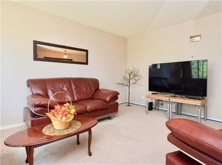 Photo 2: 816 MADEIRA Drive NE in Calgary: Marlborough Park Row/Townhouse for sale : MLS®# C4262604
