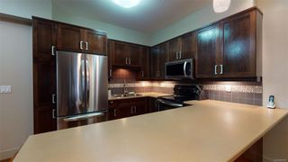 Photo 2: 101 6310 McRobb Ave in : Na North Nanaimo Condo for sale (Nanaimo)  : MLS®# 860827