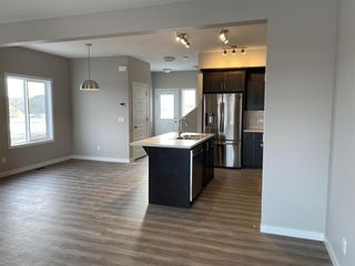 Photo 12: 1043 Lanark Boulevard: Airdrie Row/Townhouse for sale : MLS®# A1059555