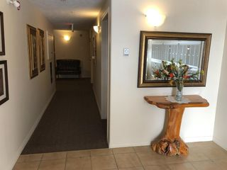 Photo 2: #201 203 Center Street: Sundre Apartment for sale : MLS®# A1050602