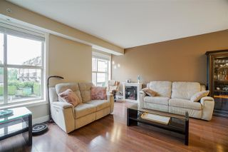"""Photo 13: 216 2110 ROWLAND Street in Port Coquitlam: Central Pt Coquitlam Townhouse for sale in """"Aviva On The Park"""" : MLS®# R2466337"""