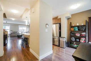 """Photo 2: 216 2110 ROWLAND Street in Port Coquitlam: Central Pt Coquitlam Townhouse for sale in """"Aviva On The Park"""" : MLS®# R2466337"""