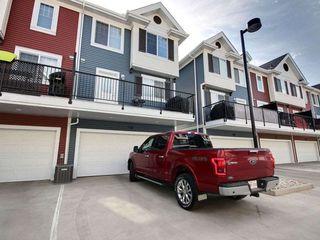 Photo 2: 106 8315 180 Avenue in Edmonton: Zone 28 Townhouse for sale : MLS®# E4171714