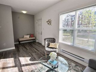 Photo 4: 106 8315 180 Avenue in Edmonton: Zone 28 Townhouse for sale : MLS®# E4171714