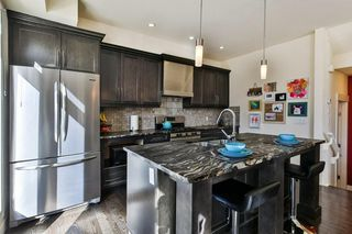 Photo 11: 142 12 Avenue NW in Calgary: Crescent Heights Row/Townhouse for sale : MLS®# C4290124
