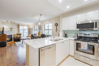 """Photo 2: 410 260 NEWPORT Drive in Port Moody: North Shore Pt Moody Condo for sale in """"THE MCNAIR"""" : MLS®# R2444010"""
