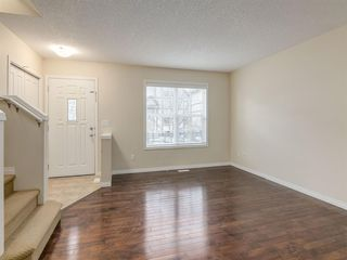 Photo 3: 1119 CRANFORD Court SE in Calgary: Cranston Row/Townhouse for sale : MLS®# A1051961