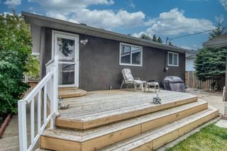 Photo 4: 419 HUNTBOURNE Hill NE in Calgary: Huntington Hills Detached for sale : MLS®# A1033993