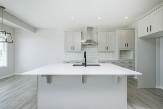 Photo 12: 89 Creekside Way SW in Calgary: C-168 Detached for sale : MLS®# A1013282