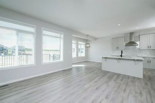 Photo 7: 89 Creekside Way SW in Calgary: C-168 Detached for sale : MLS®# A1013282