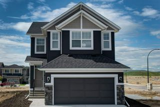 Photo 2: 89 Creekside Way SW in Calgary: C-168 Detached for sale : MLS®# A1013282