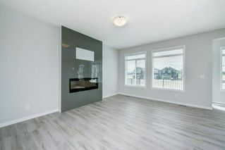 Photo 5: 89 Creekside Way SW in Calgary: C-168 Detached for sale : MLS®# A1013282