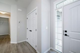 Photo 3: 89 Creekside Way SW in Calgary: C-168 Detached for sale : MLS®# A1013282