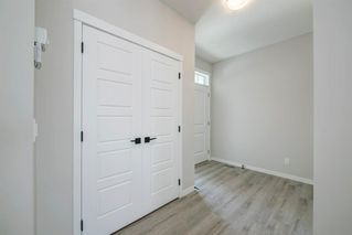 Photo 4: 89 Creekside Way SW in Calgary: C-168 Detached for sale : MLS®# A1013282