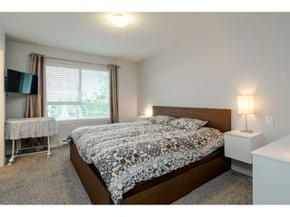 "Photo 16: 10 7088 191 Street in Surrey: Clayton Townhouse for sale in ""Montana"" (Cloverdale)  : MLS®# R2500322"