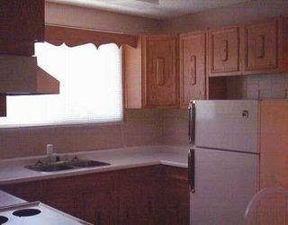 Photo 2: 748 OAK Street in Winnipeg: River Heights / Tuxedo / Linden Woods Single Family Detached for sale (South Winnipeg)  : MLS®# 2509883