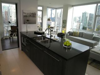 """Photo 1: 1203 1455 HOWE Street in Vancouver: False Creek North Condo for sale in """"POMARIA"""" (Vancouver West)  : MLS®# V671821"""