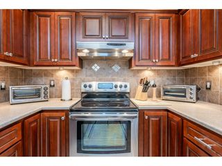 """Photo 8: 9769 148A Street in Surrey: Guildford Townhouse for sale in """"Chelsea Gate"""" (North Surrey)  : MLS®# R2394189"""