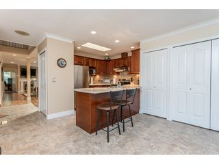 """Photo 10: 9769 148A Street in Surrey: Guildford Townhouse for sale in """"Chelsea Gate"""" (North Surrey)  : MLS®# R2394189"""