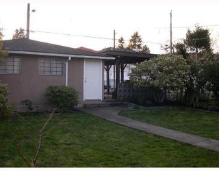 Photo 7: 5407 DUMFRIES Street in Vancouver: Knight House for sale (Vancouver East)  : MLS®# V696589