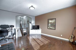 Photo 21: 45 Cougarstone Manor SW in Calgary: Cougar Ridge Detached for sale : MLS®# A1052755