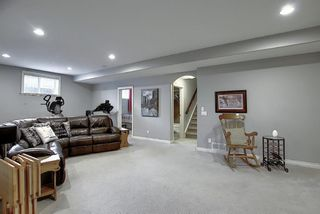 Photo 33: 45 Cougarstone Manor SW in Calgary: Cougar Ridge Detached for sale : MLS®# A1052755
