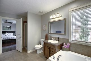 Photo 26: 45 Cougarstone Manor SW in Calgary: Cougar Ridge Detached for sale : MLS®# A1052755