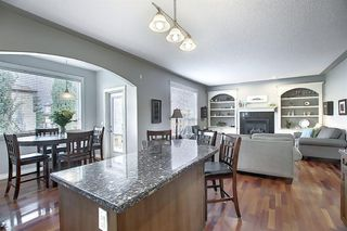 Photo 7: 45 Cougarstone Manor SW in Calgary: Cougar Ridge Detached for sale : MLS®# A1052755