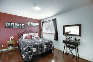 Photo 28: 45 Cougarstone Manor SW in Calgary: Cougar Ridge Detached for sale : MLS®# A1052755